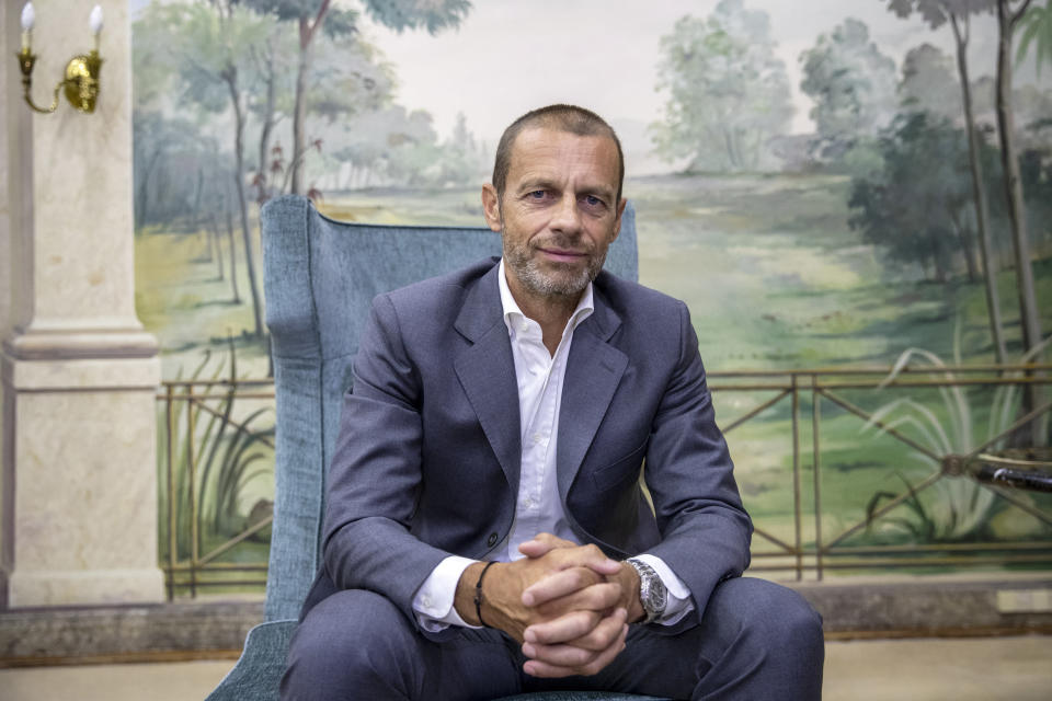 """UEFA President Aleksander Ceferin poses for a picture during an interview with The Associated Press in Lisbon, Portugal, Sunday, Aug. 23, 2020. Ceferin stressed he would consult widely before pushing for any permanent changes to the format, but said many people were """"extremely excited"""" by the final eight format adopted because of the coronavirus pandemic.(AP Photo/Manu Fernandez)"""