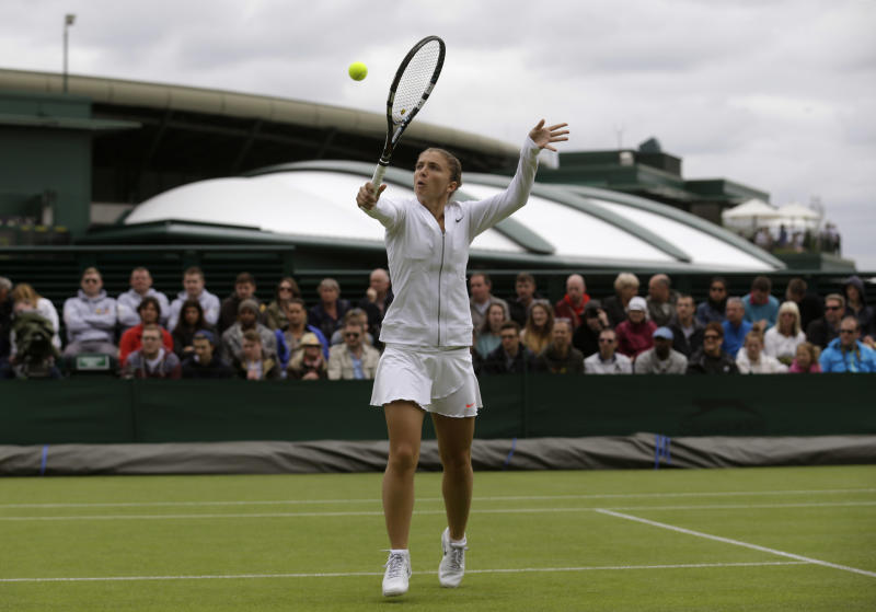 Sara Errani of Italy returns the ball to Monica Puig of Puerto Rico in their Women's first round singles match at the All England Lawn Tennis Championships in Wimbledon, London, Monday, June 24, 2013. (AP Photo/Anja Niedringhaus)