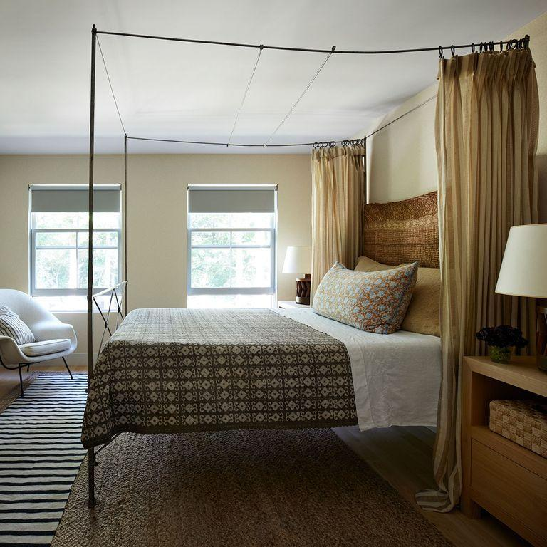 """<p>Cozy patterns and textures can work well together in any context. For fall, these neutral textiles along with tan and khaki textured details, like the headboard and rug, bring a sense of style and comfort to this <a href=""""https://www.elledecor.com/design-decorate/house-interiors/a35483499/sharone-einhorn-house-east-hampton/"""" rel=""""nofollow noopener"""" target=""""_blank"""" data-ylk=""""slk:East Hampton, New York, guest bedroom"""" class=""""link rapid-noclick-resp"""">East Hampton, New York, guest bedroom</a>.<br></p>"""