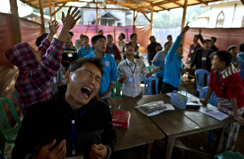In this photo taken on Feb 12, 2013, Nlan Shawang, foreground, and other camp residents sing Christian gospel songs at the Kachin Baptist Convention's rehabilitation camp in Myitkyina, the provincial capital of Kachin state, Myanmar. Myitkyina is known for having one of the highest concentrations of drug addicts in the world. The Kachin Baptist Convention, an evangelical group with over 300 churches in the state, says nearly 80 percent of ethnic Kachin youth are addicts. Their drug of choice is heroin. In the shadow of war, even drug abuse becomes politicized. Gryung Heang, the pastor of the camp church, says the government is willfully turning a blind eye to drug abuse among the Kachin because it wants to decimate young potential fighters. Officials say such views are absurd. (AP Photo/Gemunu Amarasinghe)