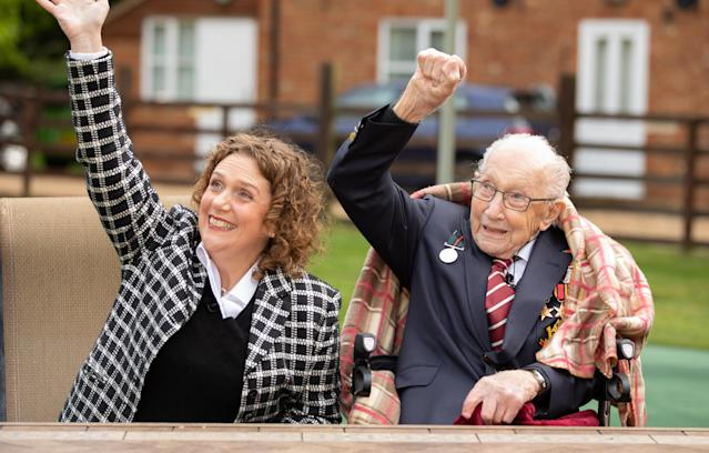 Capt Tom Moore and his daughter Hannah celebrate his 100th birthday, with an RAF flypast provided by a Spitfire and a Hurricane over his home. (Getty)