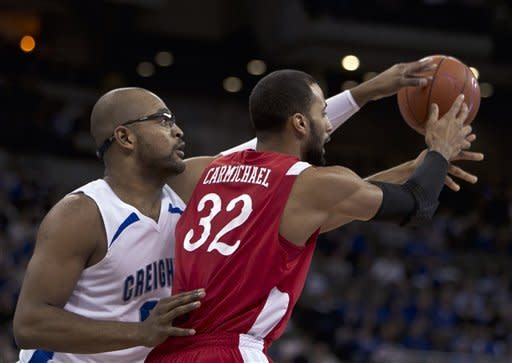 Creighton's Gregory Echenique, left, knocks the ball away from Illinois State's Jackie Carmichael in the first half of an NCAA college basketball game in Omaha, Neb., Wednesday, Feb. 1, 2012. (AP Photo/Nati Harnik)