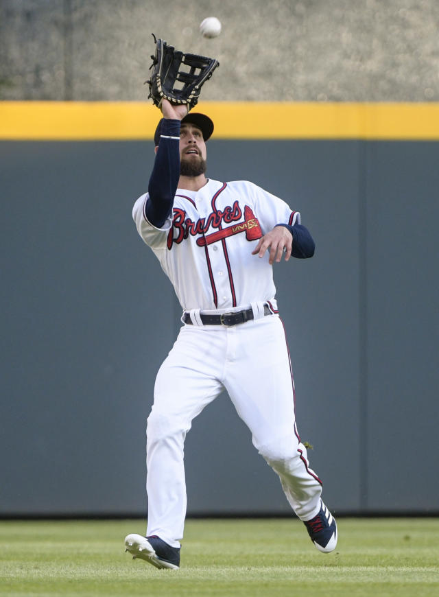 Atlanta Braves center fielder Ender Inciarte catches a fly ball hit by New York Mets' Brandon Nimmo during the first inning of a baseball game Tuesday, June 12, 2018, in Atlanta. (AP Photo/John Amis)