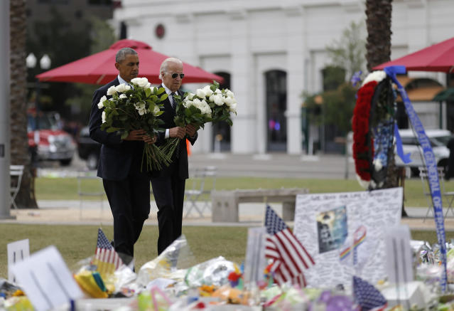 <p>President Obama and Vice President Biden take flowers to a makeshift memorial for the shooting victims of the Orlando massacre, June 16, 2016. (Carlos Barria/Reuters) </p>