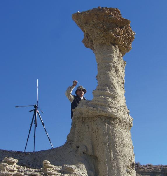 A scientist measuring a hoodoo in Red Rock Canyon, Calif. The strange rock formation could provide clues to shaking during past earthquakes.