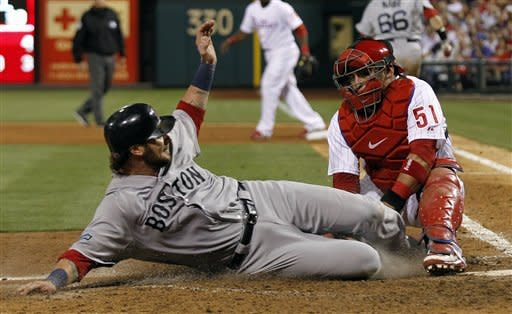 Boston Red Sox's Jarrod Saltalamacchia, left, is out on the tag by Philadelphia Phillies catcher Carlos Ruiz during the eighth inning of an interleague baseball game on Saturday, May 19, 2012, in Philadelphia. The Red Sox won 7-5. (AP Photo/Alex Brandon)