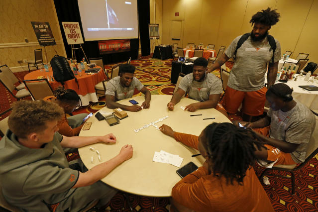 Members of the Texas Longhorns football team play dominoes Friday Sept. 6, 2019 at the team hotel in Austin, Tx. ( Photo by Edward A. Ornelas )