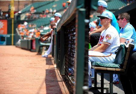 Jun 17, 2018; Baltimore, MD, USA; Baltimore Orioles first baseman Chris Davis (19) watches from the dugout during the game against the Miami Marlins at Oriole Park at Camden Yards. Mandatory Credit: Evan Habeeb-USA TODAY Sports