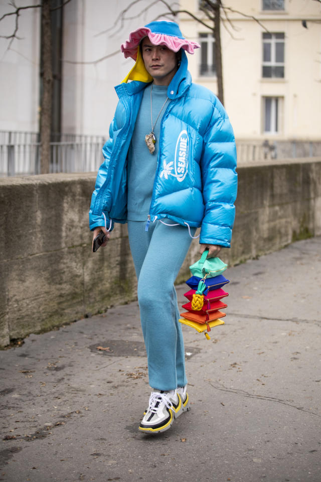 <p>Yu Masui was spotted outside Sacai on day eight in a pastel blue puffer jacket, crochet hat with a primary-hued bag to hand. <em>[Photo: Getty]</em> </p>