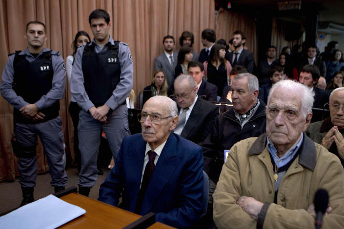 Former dictators Jorge Rafael Videla, second from right, and Reynaldo Bignone, right, wait to listen the verdict of Argentina's historic stolen babies trial in Buenos Aires, Argentina, Thursday, July 5, 2012. The two former dictators and a handful of other retired military and police officials are accused of systematically stealing babies from leftists who were kidnapped and killed when a military junta ran the country three decades ago. (AP Photo/Natacha Pisarenko)