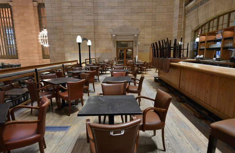 The coronavirus crisis is hitting the restaurant industry hard -- this empty eatery is at Grand Central Station in New York (AFP Photo/Angela Weiss)
