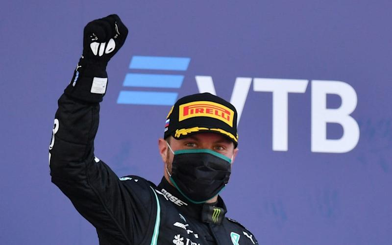 Race winner Valtteri Bottas of Finland and Mercedes GP celebrates on the podium during the F1 Grand Prix of Russia at Sochi Autodrom on September 27, 2020 in Sochi, Russia - Getty Images/ Dan Mullan