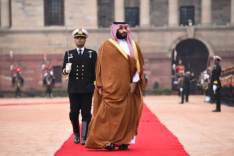 Saudi Crown Prince Mohammed bin Salman (C), pictured in India, authorized the Rapid Intervention Group to suppress dissidents, The New York Times reported