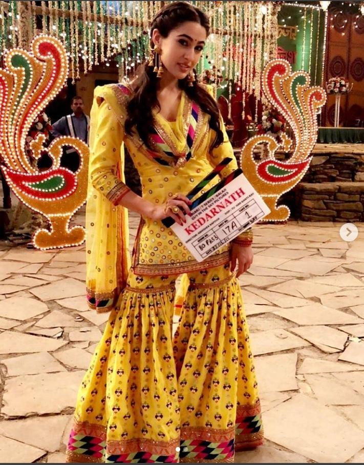 <p>New comer Sara carries this bright yellow sharara, with élan and dances in it with grace. This entire look, from Kedarnath, a movie that has the main lead mostly in plain garb, is certainly going to rule the street fashion in this country, much like Deepika Padukone's kurti-legging combo did after Love Aaj Kal. </p>