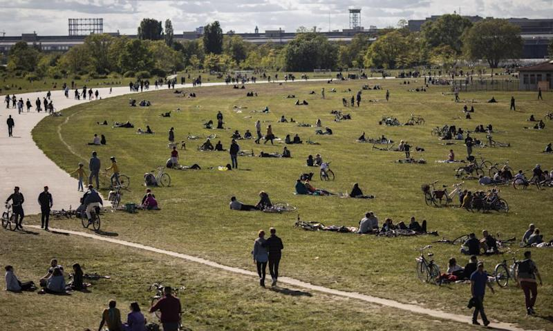 People enjoy warm weather in Tempelhofer Feld, the former Tempelhof airport that is now a public park, on May 17, 2020 in Berlin, Germany.