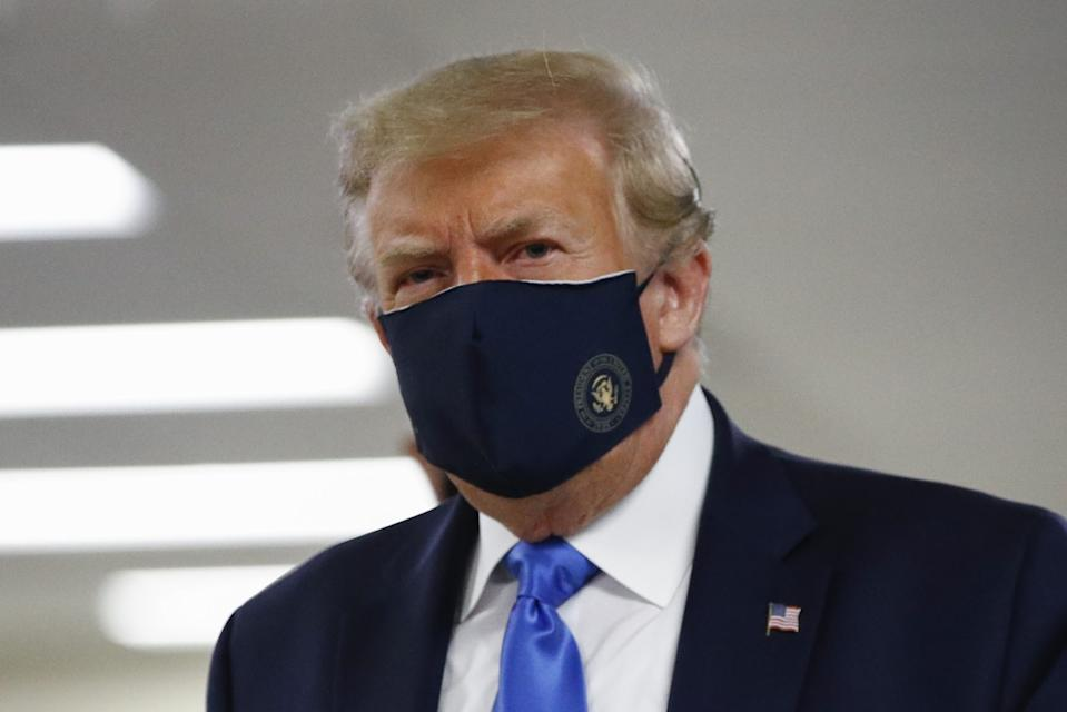President Trump wears a face mask on a visit to Walter Reed medical center in Bethesda, Md.