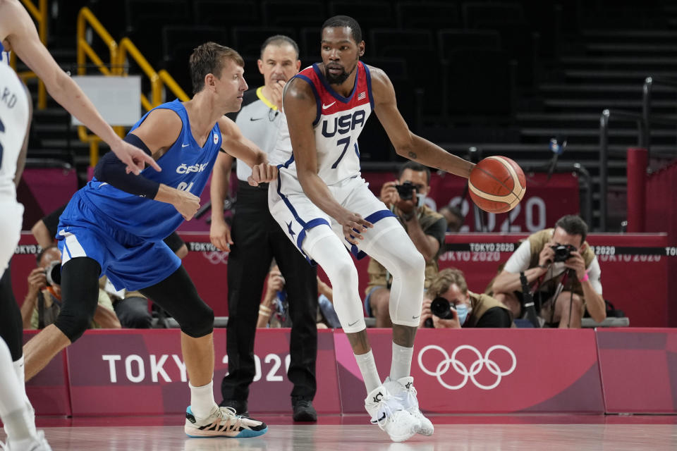 United States's Kevin Durant (7) works the ball against Czech Republic's Jan Vesely (24) during a men's basketball preliminary round game at the 2020 Summer Olympics, Saturday, July 31, 2021, in Saitama, Japan. (AP Photo/Eric Gay)