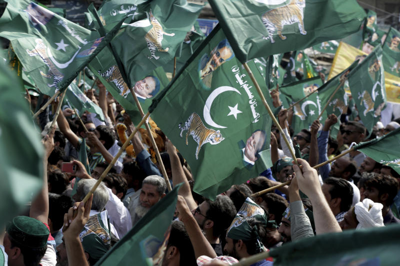 Supporters of Pakistan's former prime minister Nawaz Sharif rally to receive their leader in Lahore, Pakistan, Friday, July 13, 2018. Sharif returned late Friday from London along with his daughter, Maryam, to face a 10-year prison sentence on corruption charges, anti-corruption officials said. Maryam Sharif faces seven years in jail. (AP Photo/K.M. Chaudary)