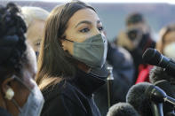 U.S. Rep. Alexandria Ocasio-Cortez talks to the media before volunteering at the Houston Food Bank on Saturday, Feb. 20, 2021. President Joe Biden declared a major disaster in Texas on Friday, directing federal agencies to help in the recovery. (Elizabeth Conley/Houston Chronicle via AP)