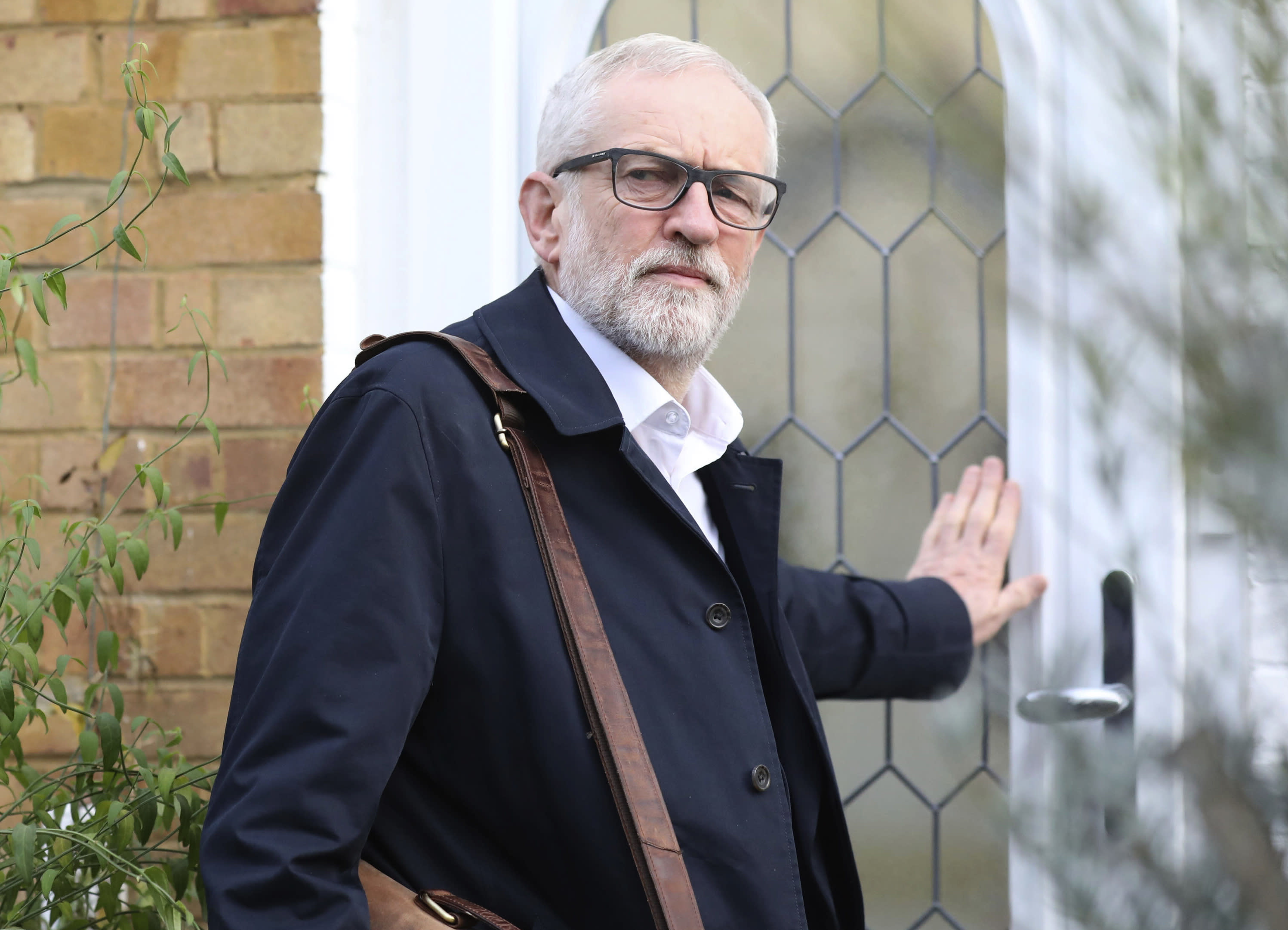 Labour Party leader Jeremy Corbyn leaves his home in Islington, north London, Monday, Dec. 16, 2019. (Isabel Infantes/PA via AP)