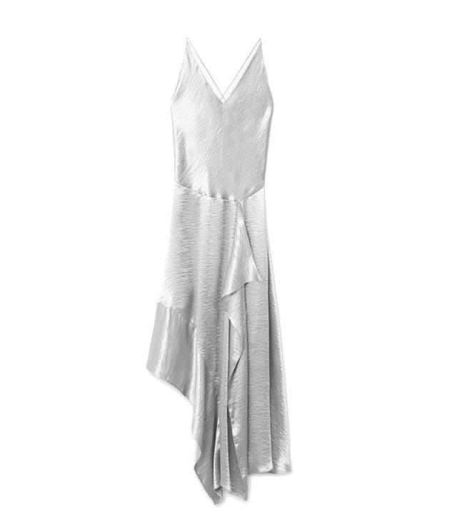 "<p>Ruffle Metallic Dress, $130, <a href=""https://shop.mango.com/us/women/dresses-long/ruffle-metallic-dress_11057683.html?c=PL&n=1&s=prendas.familia;32"" rel=""nofollow noopener"" target=""_blank"" data-ylk=""slk:mango.com"" class=""link rapid-noclick-resp"">mango.com</a> </p>"