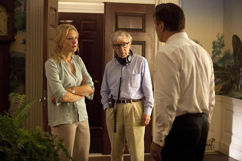 """This publicity image released by Sony Pictures Classics shows, actress Cate Blanchett, left, director Woody Allen, center, and Alec Baldwin on the set of """"Blue Jasmine."""" Allen will receive the Cecil B. DeMille Award at Sunday's ceremony. (AP Photo/Sony Pictures Classics)"""
