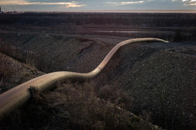 A water intake pipe for oil sands operations leads downhill to the Athabasca River on April 28, 2015 north of Fort McMurray, Canada