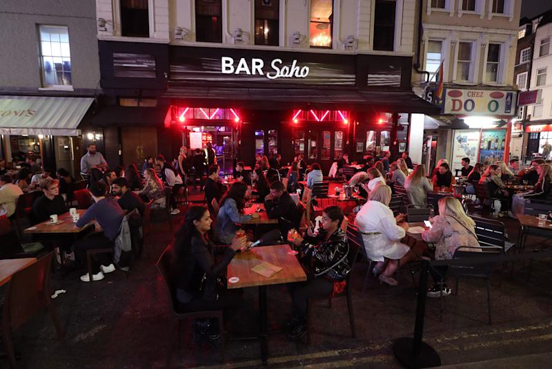 Late-night drinkers after 10pm in Soho, London, after Prime Minister Boris Johnson announced that from Thursday pubs and restaurants will be subject to a 10pm curfew to combat the rise in coronavirus cases in England. (Photo: PA)