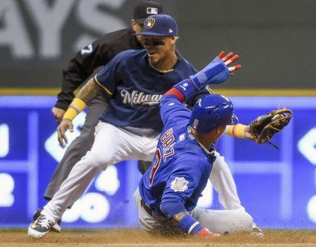 Jun 11, 2018; Milwaukee, WI, USA; Chicago Cubs second baseman Javier Baez (9) steals second base before the tag by Milwaukee Brewers shortstop Orlando Arcia (3) in the fifth inning at Miller Park. Mandatory Credit: Benny Sieu-USA TODAY Sports