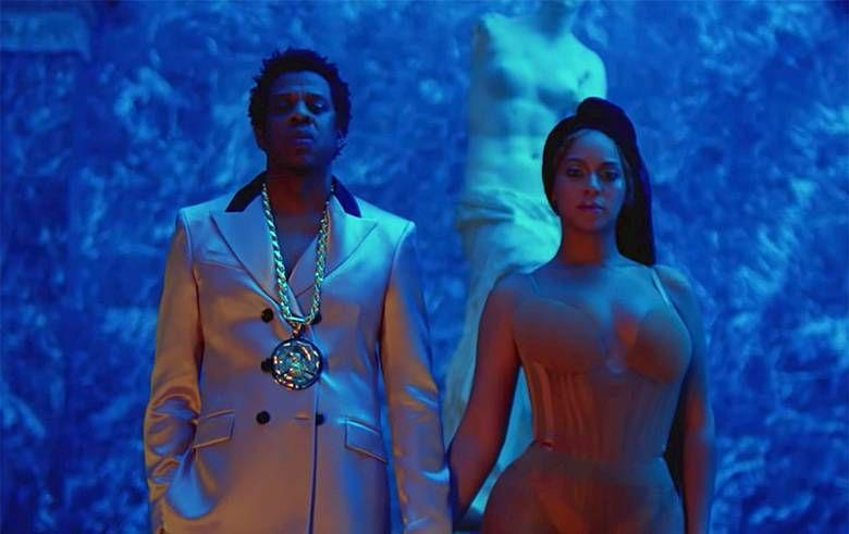 <p>With the Louvre as their backdrop, Beyoncé and Jay-Z created tableaus that mixed high art, fashion, and performance throughout their Apes**t music video. In this scene, Beyoncé is standing under the <em>Venus de Milo</em>, her body mimicking the s-curve of the sculpture in reverse with her chest and hip outwards rather than concave. As a model for Western, Euro-centric beauty, the Venus (also known as the Greek goddess Aphrodite) juxtaposes Beyoncé's stance on black female empowerment. The goddess also represents love, fertility, and desire, which Beyoncé channels through her barely-there bodysuit and her proud stance next to her husband.</p>