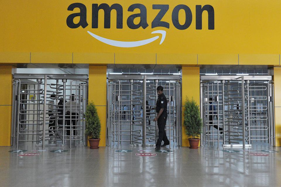 An Indian security guard walks inside Amazon's largest Fulfillment Centre (FC) in India, on the outskirts of Hyderabad on September 7, 2017. / AFP PHOTO / (Photo credit should read NOAH SEELAM/AFP/Getty Images)