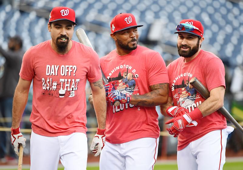 (From left to right) Washington's Anthony Rendon, Howie Kendrick and Adam Eaton warm up Friday at Nationals Park. (Getty)