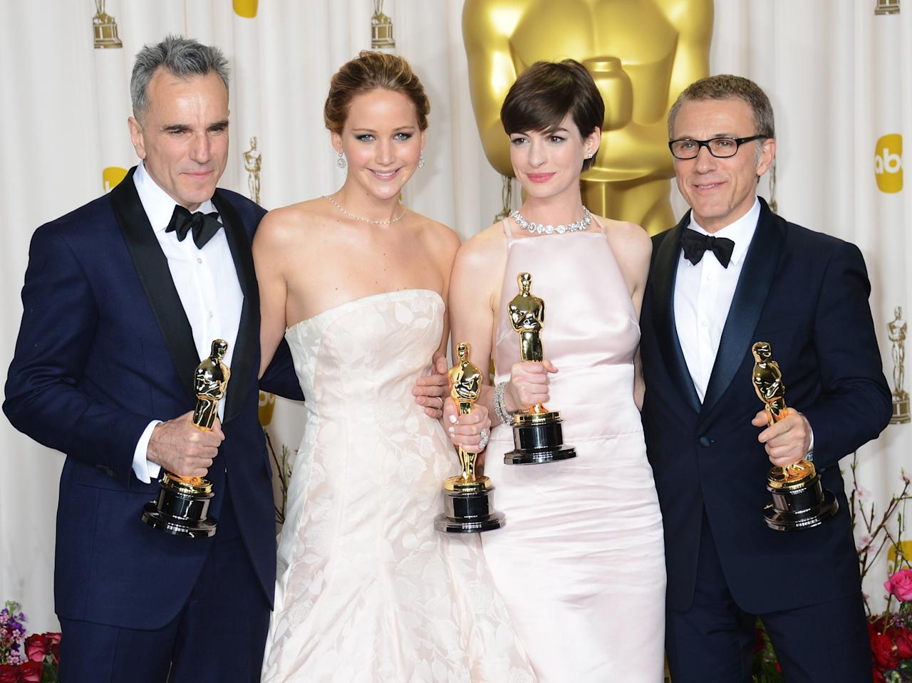 (L-R) Actors Daniel Day-Lews, Jennifer Lawrence, Anne Hathaway, and Christoph Waltz pose in the press room during the Oscars at Loews Hollywood Hotel on February 24, 2013 in Hollywood, California.  (Photo by Jeff Kravitz/FilmMagic)