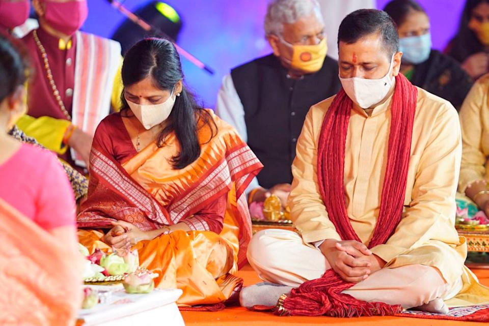 Delhi Chief Minister Arvind Kejriwal along with his wife Sunita Kejriwal offers prayers at Akshardham Temple on the occasion of Diwali, in New Delhi.