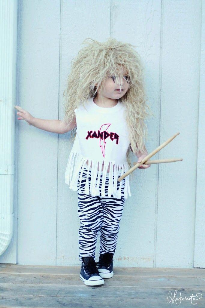 """<p>Long live rock and roll! Throw it back this Halloween with a nod to grungy '80s hair bands. Customize a ripped tee with your child's name (or band name) and draw on a few faux tattoos. </p><p><strong>Get the tutorial at <a href=""""http://www.themakerista.com/throw-back-thursday-80s-hair-band-boys/"""" rel=""""nofollow noopener"""" target=""""_blank"""" data-ylk=""""slk:The Makerista"""" class=""""link rapid-noclick-resp"""">The Makerista</a>. </strong></p><p><strong><a class=""""link rapid-noclick-resp"""" href=""""https://www.amazon.com/Gerber-Toddler-Leggings-animal-prints/dp/B072JNSD6J/?tag=syn-yahoo-20&ascsubtag=%5Bartid%7C10050.g.4975%5Bsrc%7Cyahoo-us"""" rel=""""nofollow noopener"""" target=""""_blank"""" data-ylk=""""slk:SHOP ANIMAL PRINT LEGGINGS"""">SHOP ANIMAL PRINT LEGGINGS</a><br></strong></p>"""