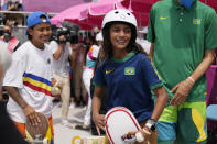 Margielyn Didal of Philippines, left, and Rayssa Leal of Brazil are seen after the women's street skateboarding finals at the 2020 Summer Olympics, Monday, July 26, 2021, in Tokyo, Japan. (AP Photo/Ben Curtis)
