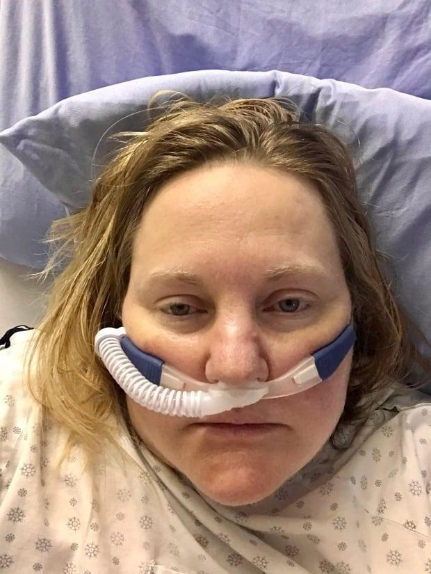 Janine Fisher, 51, spent a month in hospital, including several weeks in intensive care, after testing positive for the B117 coronavirus variant.  She wants Albertans to know COVID-19 is no joke. (Janine Fisher - image credit)