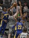 San Antonio Spurs' Jakob Poeltl (25) and Keldon Johnson, right rear, fight for the rebound against Indiana Pacers' Edmond Sumner (5) Caris LeVert (22) and Myles Turner during the second half of an NBA basketball game on Saturday, April 3, 2021, in San Antonio. (AP Photo/Darren Abate)
