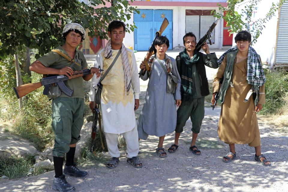 Militiamen loyal to a northern warlord pose for a photo