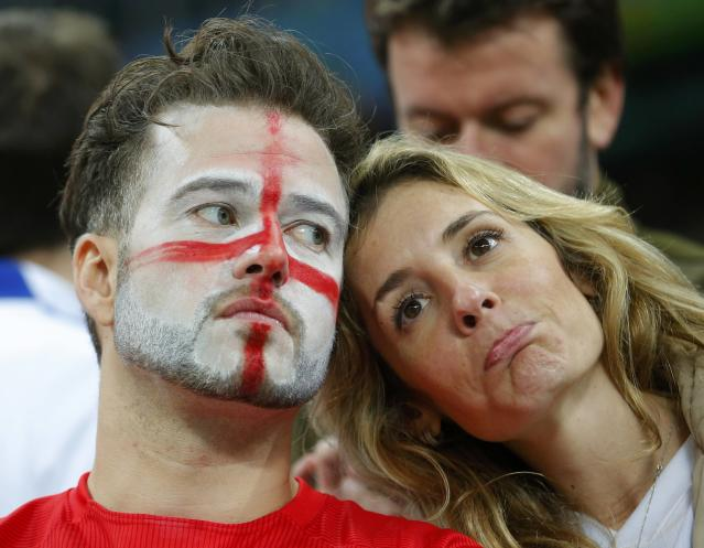 England fans react to their team losing to Uruguay during their 2014 World Cup Group D soccer match at the Corinthians arena in Sao Paulo June 19, 2014. REUTERS/Laszlo Balogh (BRAZIL - Tags: SOCCER SPORT WORLD CUP) TOPCUP