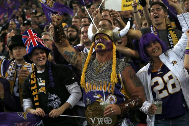 Pittsburgh Steelers and Minnesota Vikings fans react in the stands as the teams met during their NFL football game at Wembley Stadium in London, September 29, 2013. REUTERS/Suzanne Plunkett (BRITAIN - Tags: SPORT FOOTBALL)