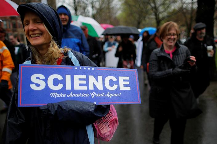 """<p>A woman carries a sign that reads """"Science,"""" in the style of a campaign sign for President Donald Trump, as demonstrators march down Commonwealth Avenue during a """"March for Science"""" rally in Boston, April 22, 2017. (Photo: Brian Snyder/Reuters) </p>"""