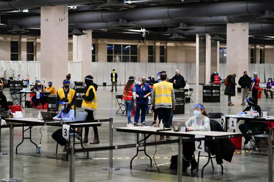 FILE - In this Feb. 3, 2021, file photo, COVID-19 vaccination site is set up at the Pennsylvania Convention Center in Philadelphia. The clinic opened to help provide second doses of the vaccine. (AP Photo/Matt Rourke, File)