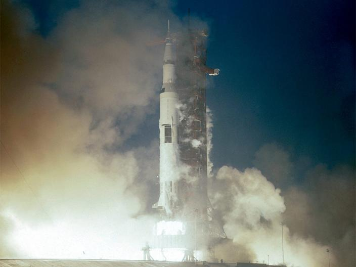 Apollo 12 launches in stormy weather.