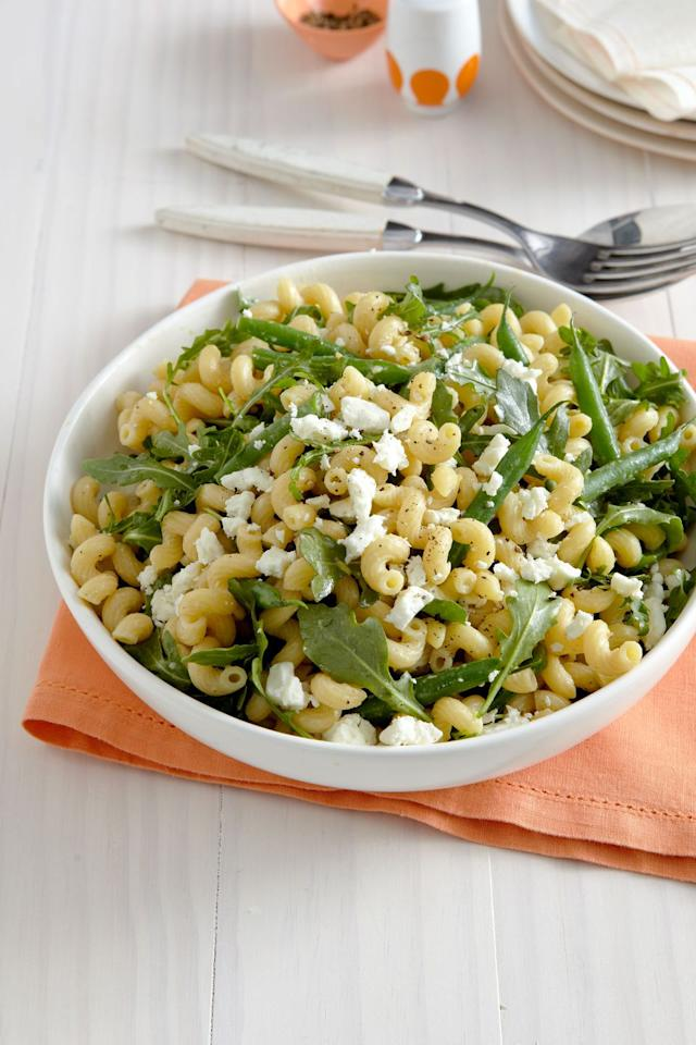 "<p>This salad combines the sweetness of green beans with the creamy saltiness of feta, balanced by hearty pasta and peppery arugula. </p><p><strong><a rel=""nofollow"" href=""https://www.womansday.com/food-recipes/food-drinks/recipes/a12275/lemony-pasta-salad-green-beans-arugula-recipe-wdy0513/"">Get the recipe.</a></strong><strong><br></strong></p><p><strong>RELATED: </strong><a rel=""nofollow"" href=""https://www.womansday.com/food-recipes/food-drinks/g2207/strawberry-desserts/""><strong>Deliciously Sweet Strawberry Recipes for Summer</strong></a><br></p>"