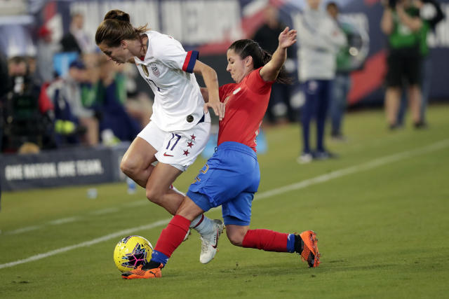 Costa Rica defender Lixy Rodriguez, right, tries to get possession of the ball from U.S. forward Tobin Heath (17) during the first half of an international friendly soccer match Sunday, Nov. 10, 2019, in Jacksonville, Fla. (AP Photo/John Raoux)