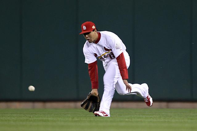 ST LOUIS, MO - OCTOBER 20: Jon Jay #19 of the St. Louis Cardinals fields a ball hit by Michael Young #10 of the Texas Rangers for the Rangers first hit of the game in the fourth inning during Game Two of the MLB World Series at Busch Stadium on October 20, 2011 in St Louis, Missouri. (Photo by Ezra Shaw/Getty Images)