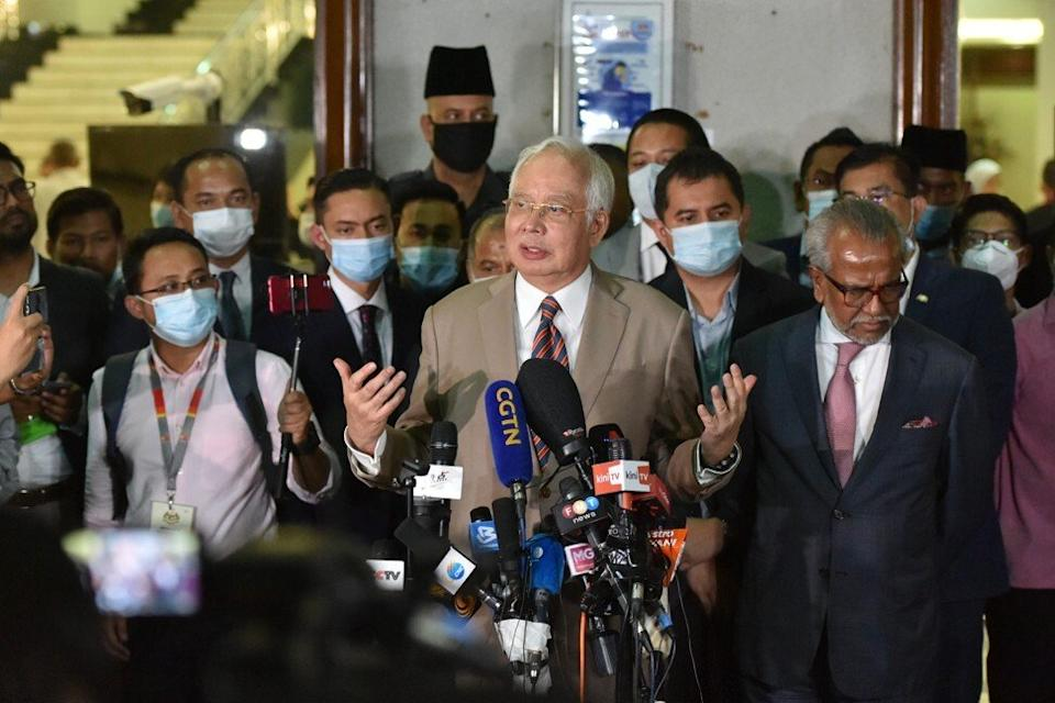 Former Malaysian Prime Minister Najib Razak (C) speaking to the media on July 28, 2020. Najib, who was defeated in a general election in 2018, was sentenced to 12 years in jail and fined 210 million ringgit (US$50.6 million) after being found guilty on seven counts of money laundering, criminal breach of trust and abuse of power in relation to the 1MDB scandal. Photo: Xinhua
