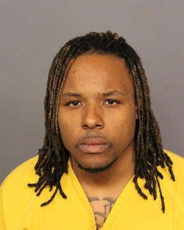 Booking photo of Suspect Hancock, 29, arrested on suspicion of first-degree murder in Denver