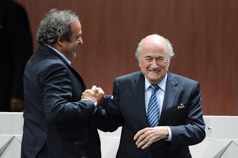 FIFA president Sepp Blatter (R) is congratulated by UEFA President Michel Platini after being re-elected during the FIFA Congress in Zurich on May 29, 2015 (AFP Photo/Fabrice Coffrini)